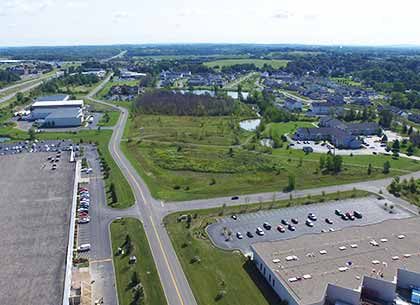Eastbound Thruway Park Drive, CooperVision (Lots H-J) and Vizix/New Cov Manufacturing (Lot Q).