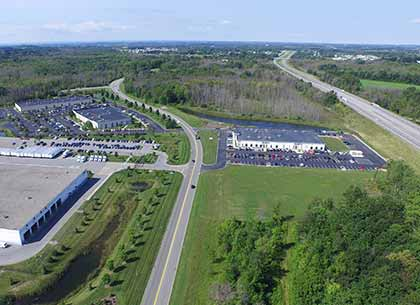 FedEx Ground (Lots S&T), ADT Customer Care Center (Lot V), ADT Service Dispatch Center (Lot U), eHealth Technologies (Lot F), counterclockwise, starting at bottom left; available space (Lots A-E) on right side of Thruway Park Drive in background; NYS Thruway along right.